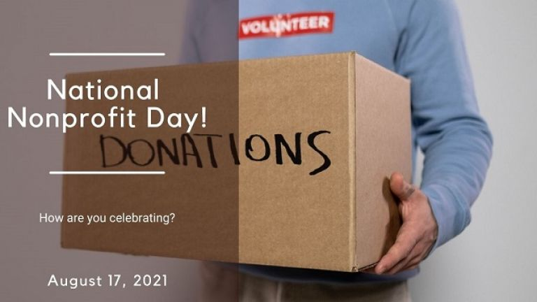 male volunteer holding donation box for national nonprofit day