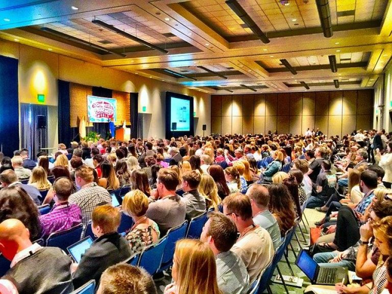 large indoor gathering at business conference