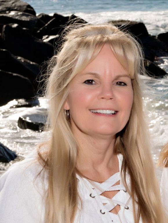 Laurie Mack, Partner